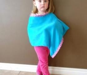 Little girl poncho Mayan fabric with polka dot trim